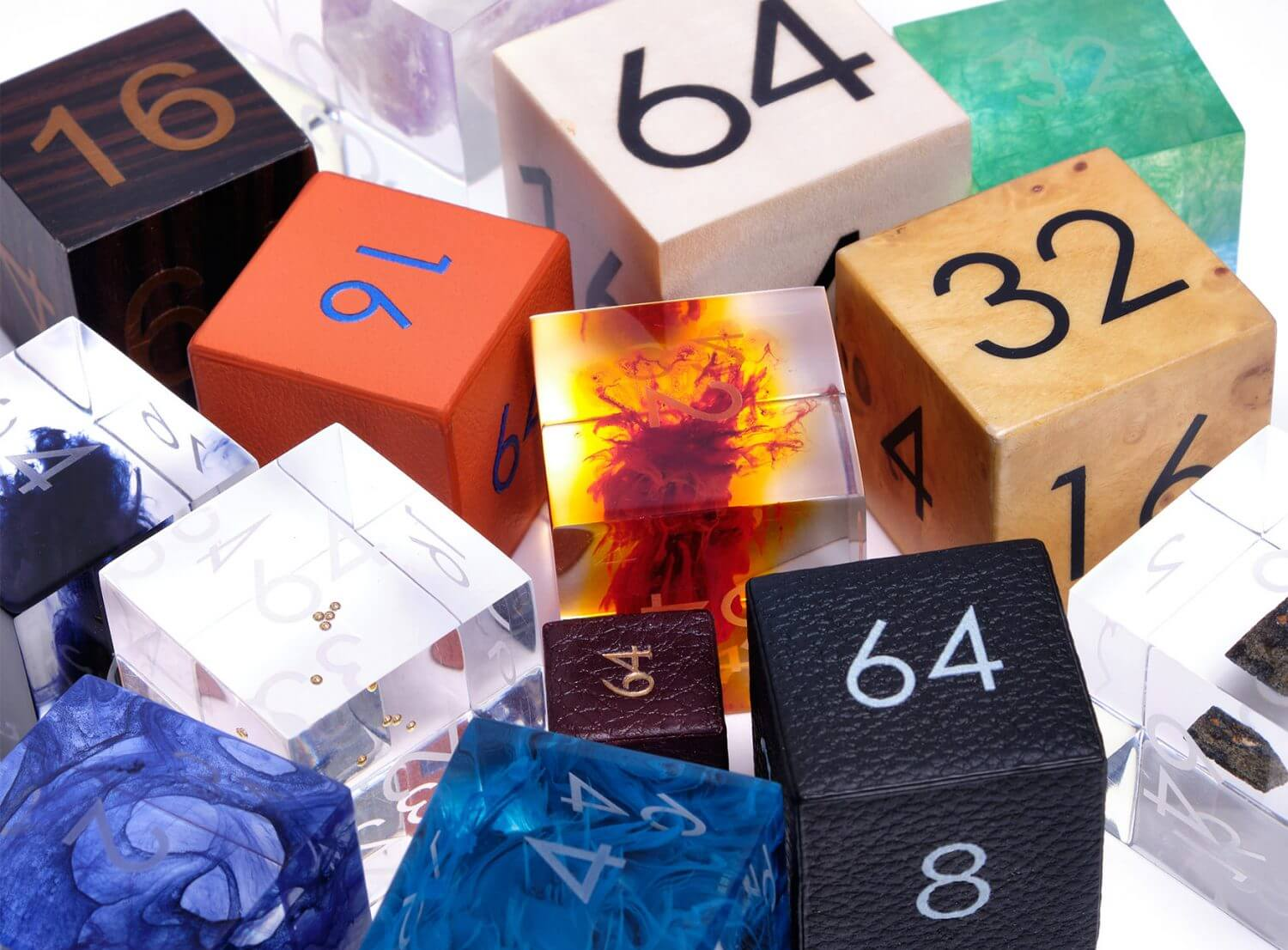 A collection of bespoke backgammon doubling dice cubes by Alexandra Llewellyn