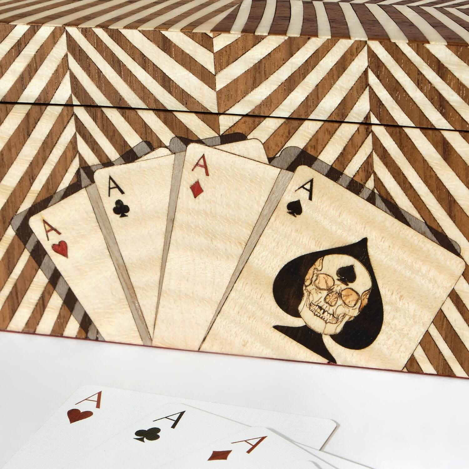 A trompe l'oeil technique created in wood marquetry creating the illusion of shadow behind marquetry playing cards on the Double Cards Box side