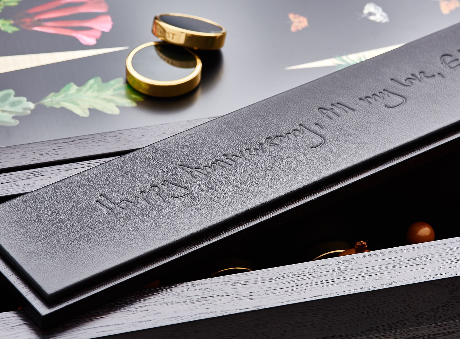 Black engraved leather reading 'Happy Anniversary, all my love'