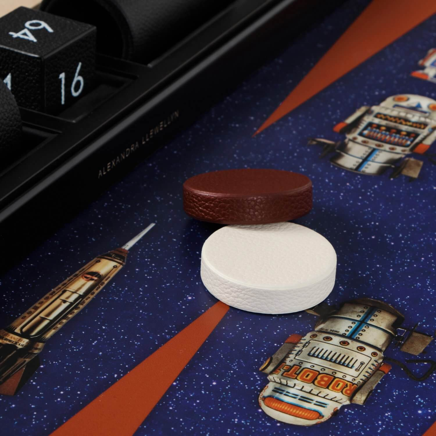 Burgundy and cream calf leather playing pieces on the Robot backgammon playing surface